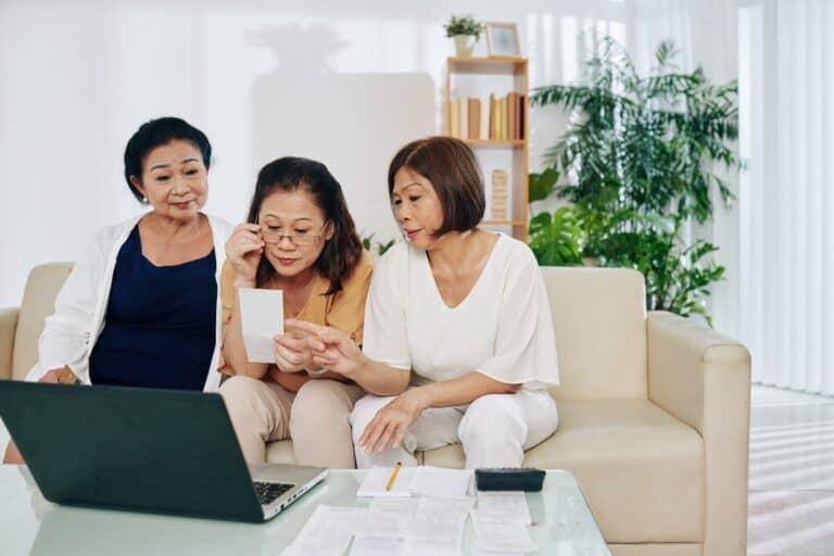 Senior women checking and discussing bills